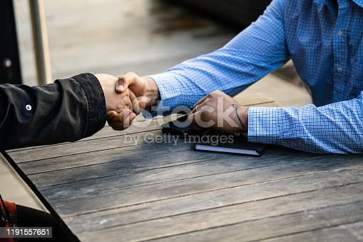 951514270 istock photo Business people negotiating a contract and shake hands 1191557651