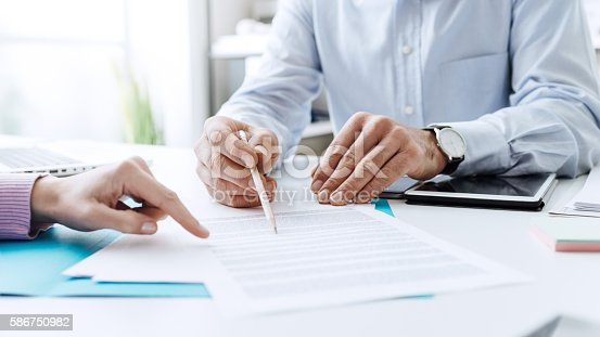 istock Business people negotiating a contract 586750982