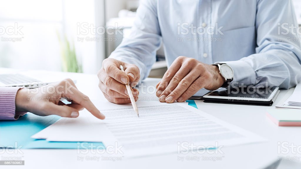 Business people negotiating a contract stock photo