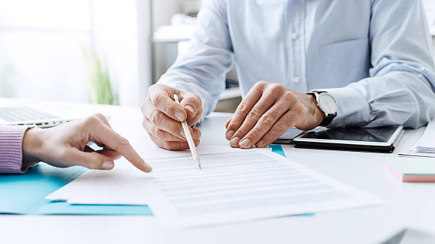 business people negotiating a contract - stock broker stock photos and pictures