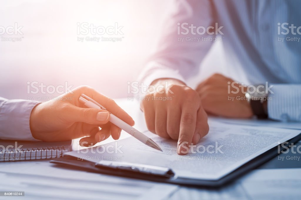 Business people negotiating a contract. stock photo