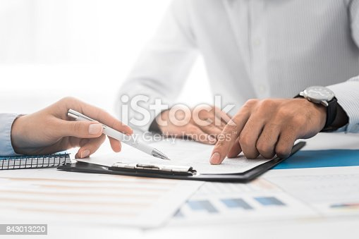 840610244istockphoto Business people negotiating a contract. 843013220