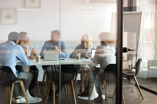 Business People Negotiating At Boardroom Behind Closed Doors Stock Photo - Download Image Now