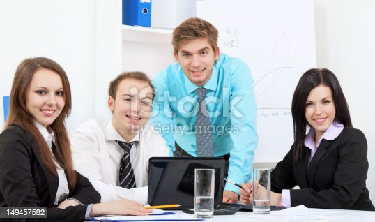 group of positive happy smile young business people at desk office, businesspeople meeting looking at camera, concept of team, working together