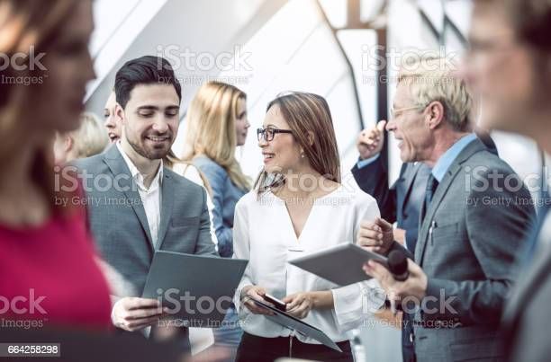 Business people on a conference event discussing picture id664258298?b=1&k=6&m=664258298&s=612x612&h=s5vicqgtsdb6nameu7pnnvze5g85aqt7i5cig8ykb1m=