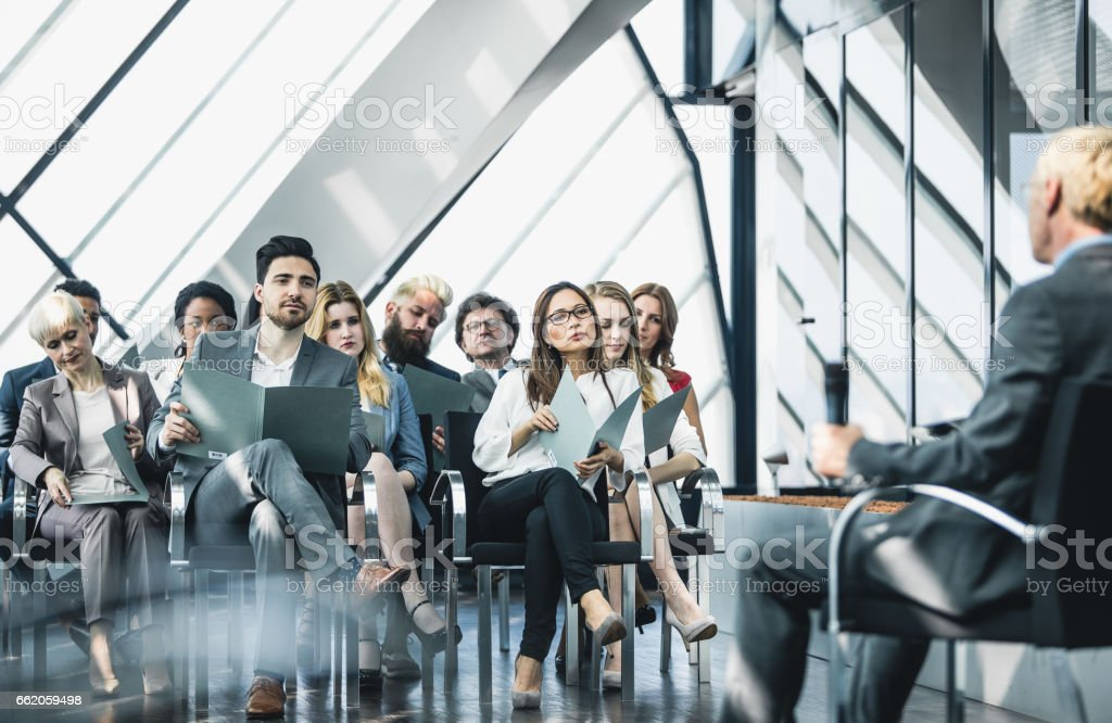 Business People on a Conference Event Listening To The Talker stock photo