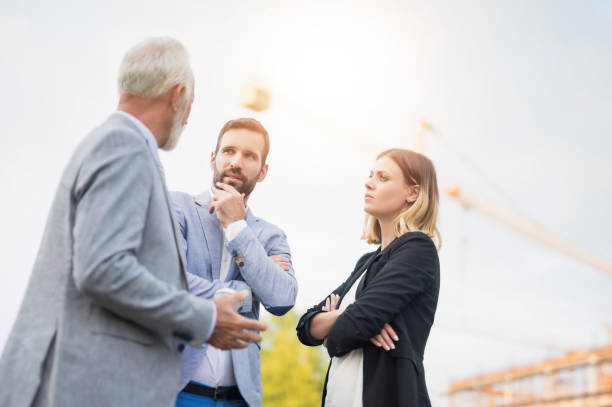 Business people on a construction site. stock photo