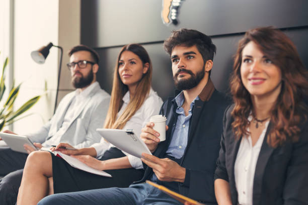 Business people on a morning briefing stock photo