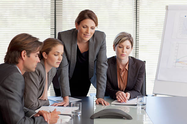 Business people on conference call  conference phone stock pictures, royalty-free photos & images