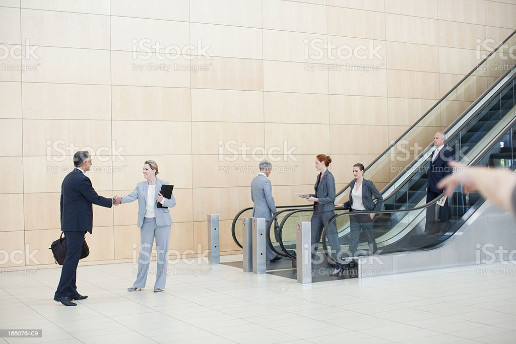 Business people on escalators royalty-free stock photo