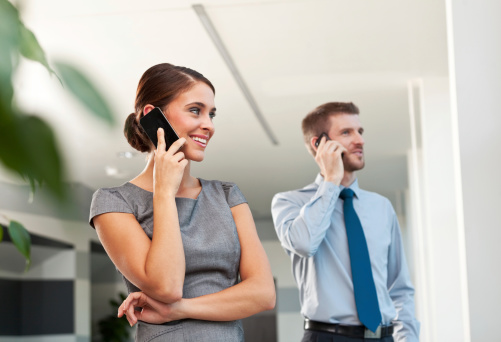 Business People On The Phones Stock Photo - Download Image Now
