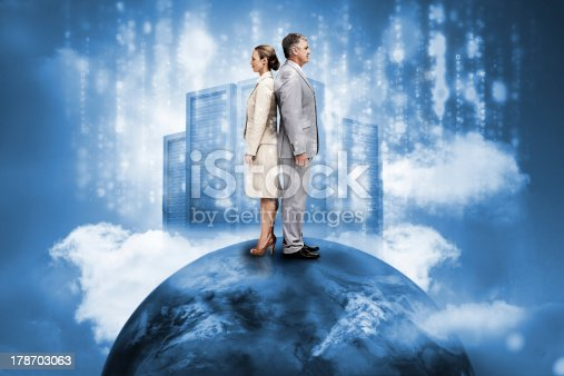 istock Business people on top of the world with data server 178703063