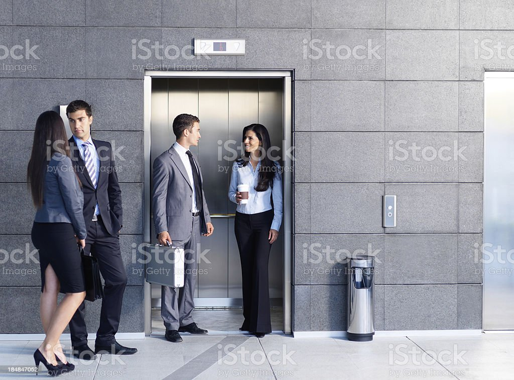 Business people outside the elevator stock photo