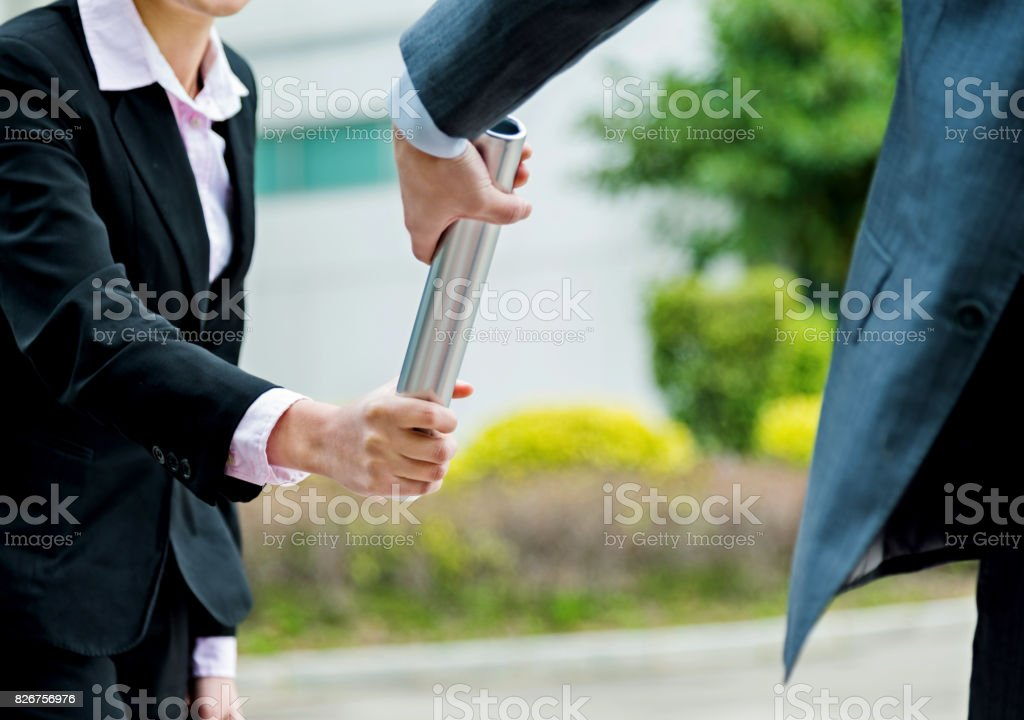 Business people passing baton stock photo