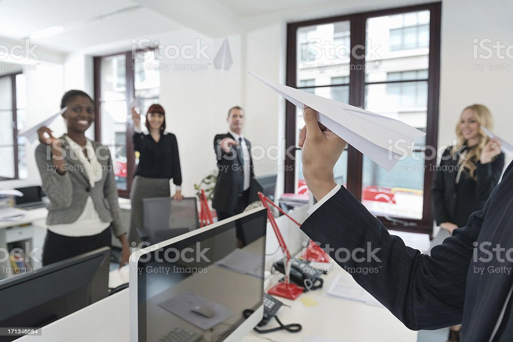 Business People Playing With Paper Airplane royalty-free stock photo