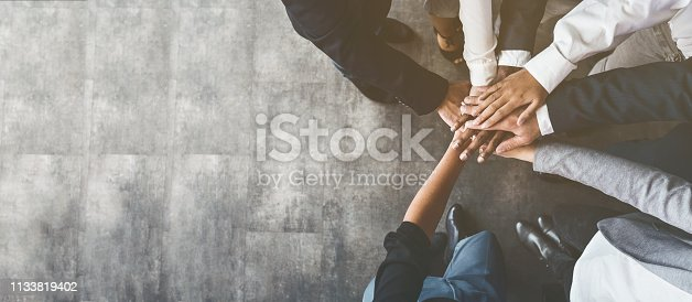 istock Business people putting their hands together, top view 1133819402