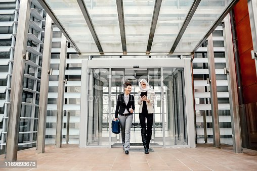 Business people quitting the office building