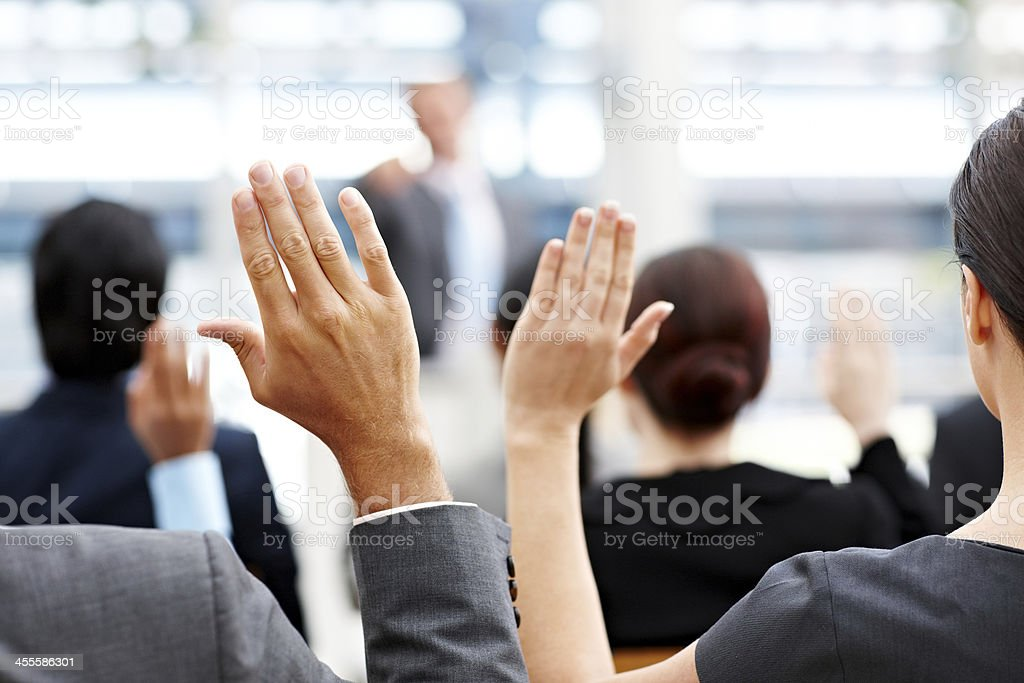 Business People Raising Their Hands stock photo