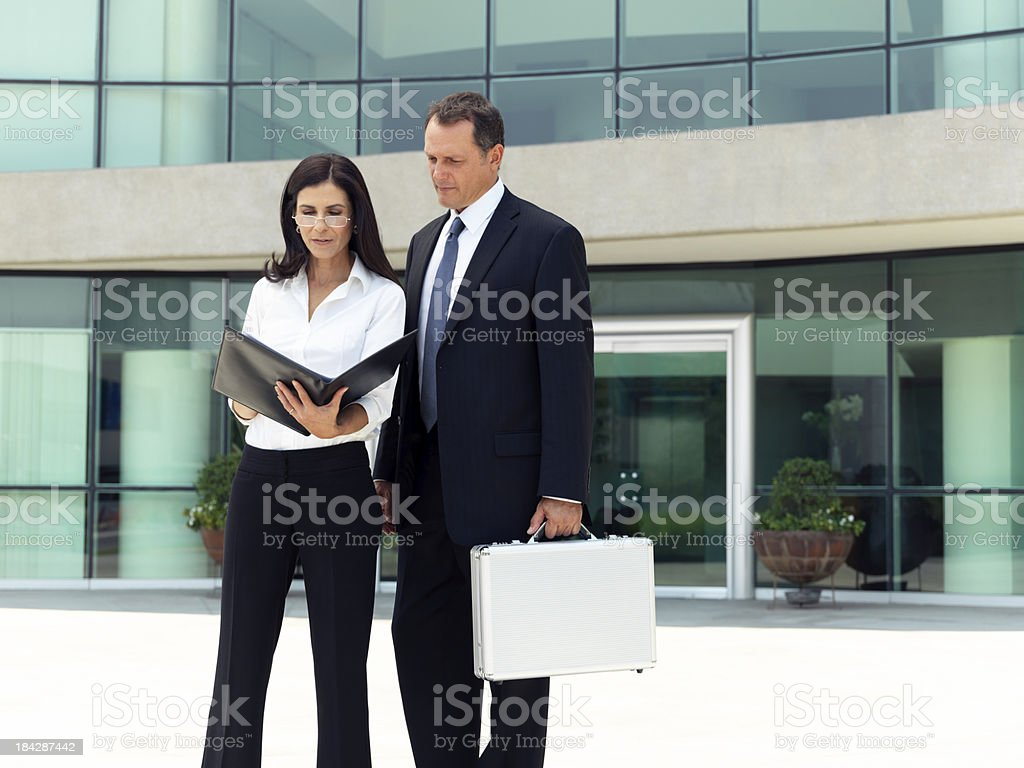 Business people reading an office document royalty-free stock photo