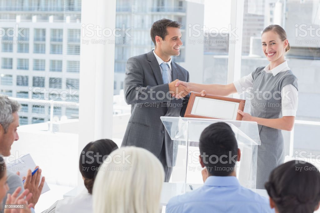Business people receiving award stock photo
