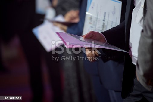 932724052 istock photo Business people receiving awards 1187895884