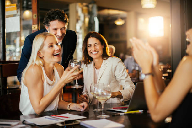 Business people relaxing after work stock photo