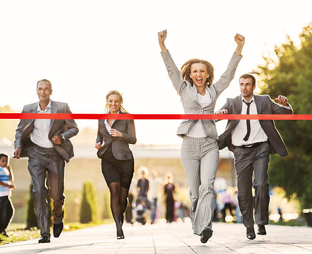 business people running to finish, crossing red line. - finishing stock photos and pictures