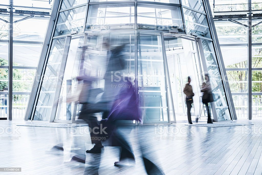 Business People Rushing Through Modern Architecture royalty-free stock photo