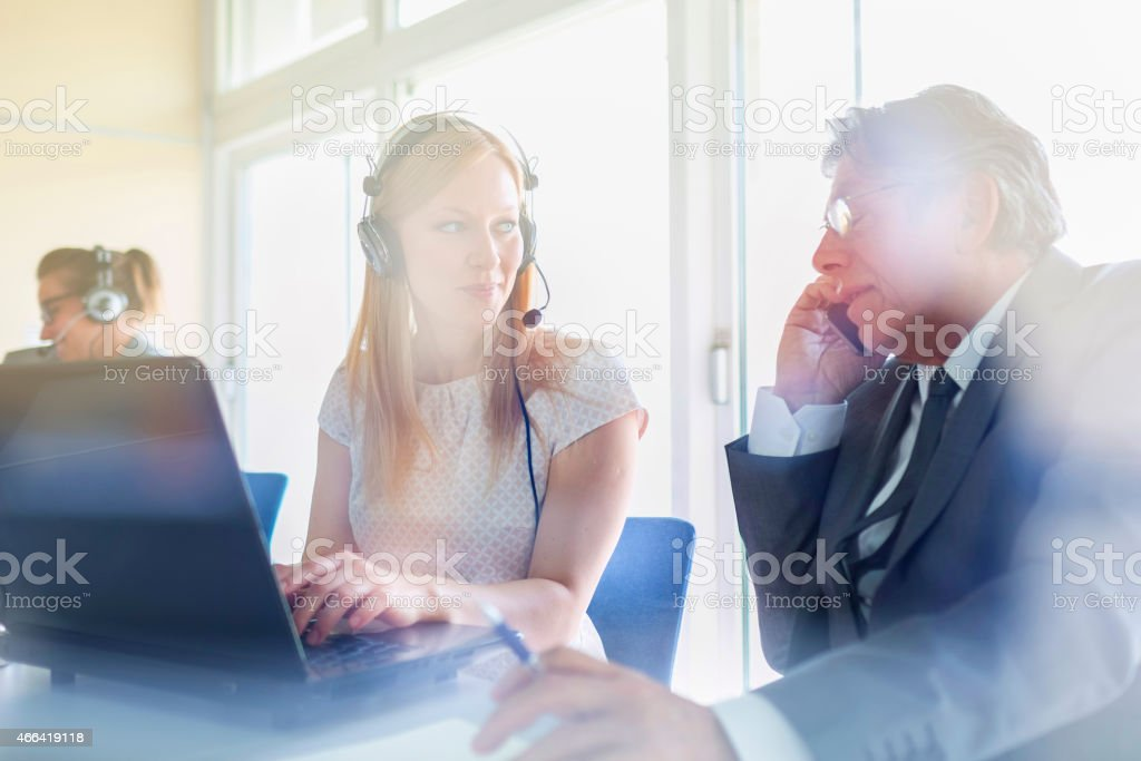 Business people, secretary, boss, office, laptop stock photo