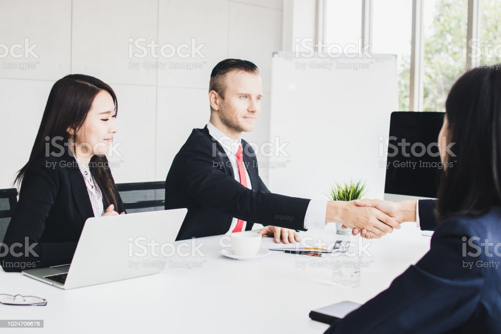 business people shake hands and talking. Successful finished panther-ship and negotiation in meeting room stock photo