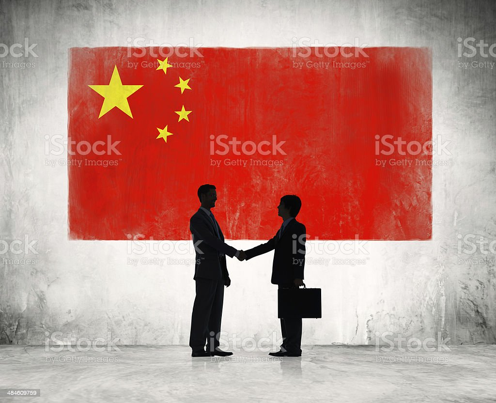 Business people shaking hand in China stock photo