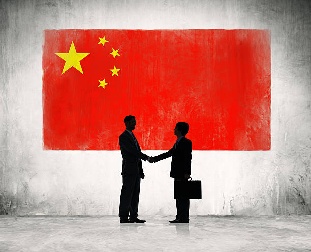 Business people shaking hand in China Business people shaking hand in China. diplomacy stock pictures, royalty-free photos & images
