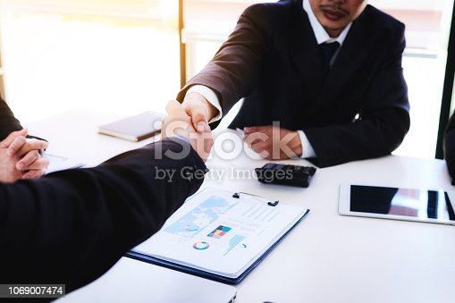 istock Business people shaking hands after finishing up a meeting good teamwork in office.Teamwork successful Meeting Workplace strategy Concept. 1069007474