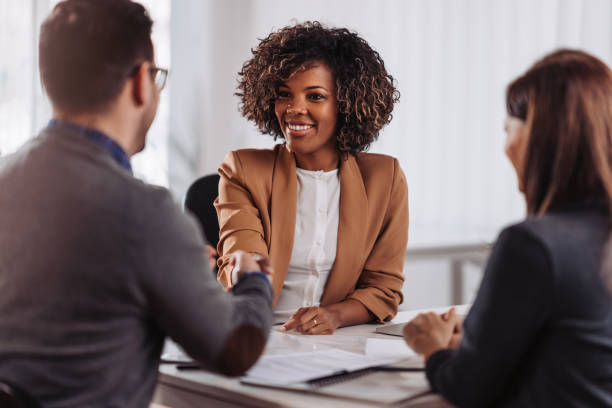 Business people shaking hands after meeting stock photo