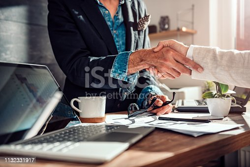 859896852istockphoto Business people shaking hands after successful meeting 1132331917