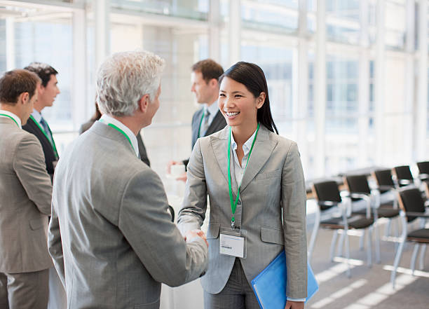 Business people shaking hands at seminar  attending stock pictures, royalty-free photos & images