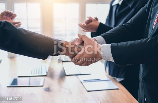 541976840 istock photo Business people shaking hands congratulations and confirmed the agreement and the investment partner. 1211817712