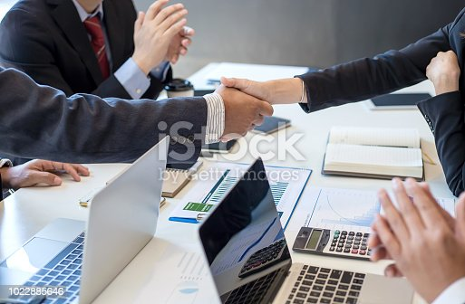 859896852istockphoto Business people shaking hands. Congratulations and success of the business. 1022885646