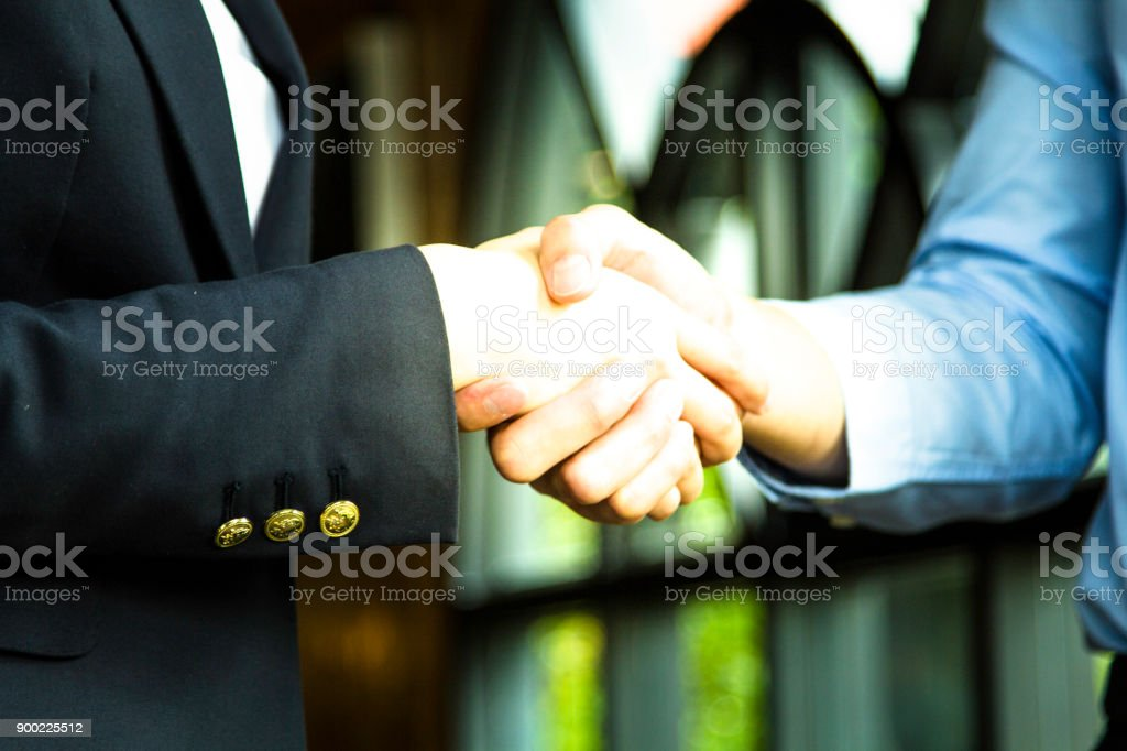 Business people shaking hands, finishing up a meeting. Close-up of...