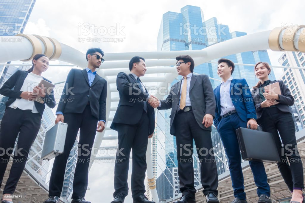 Business people shaking hands, finishing up a meeting. Negotiation benefits concept 免版稅 stock photo