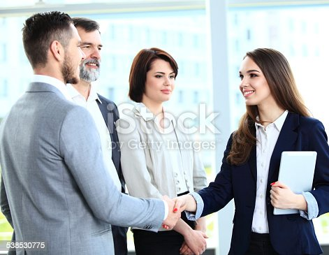 656005826istockphoto Business people shaking hands, finishing up a meeting 538530775