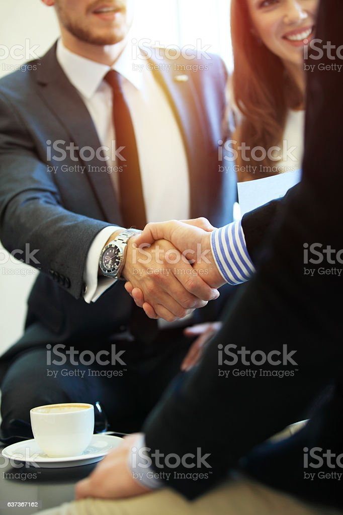 Business people shaking hands, finishing up a meeting. stock photo