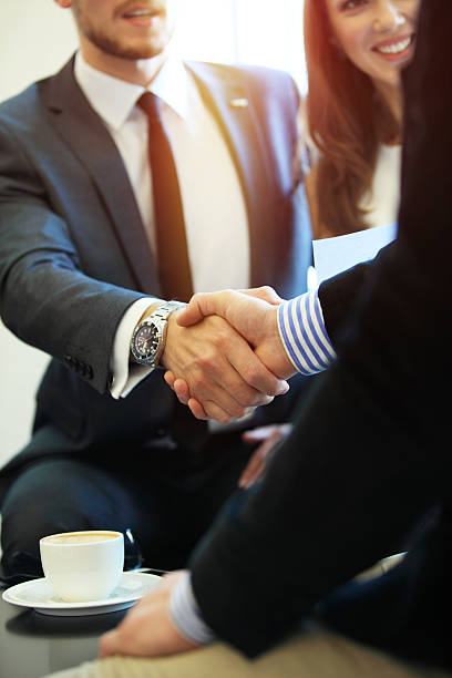 business people shaking hands, finishing up a meeting. - composizione verticale foto e immagini stock