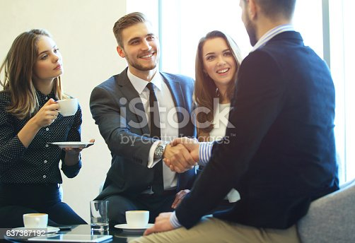 656005826istockphoto Business people shaking hands, finishing up a meeting. 637367192