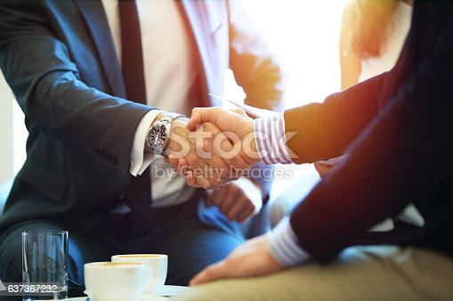 istock Business people shaking hands, finishing up a meeting 637367232