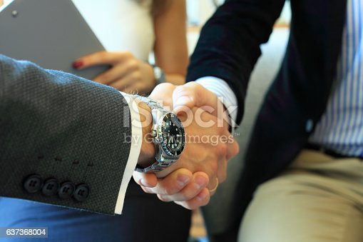 656005826istockphoto Business people shaking hands, finishing up a meeting. 637368004