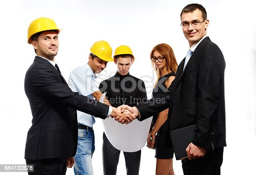 1055059750 istock photo Business people shaking hands, finishing up a meeting 684132678