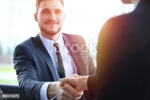 istock Business people shaking hands, finishing up a meeting. 830413372