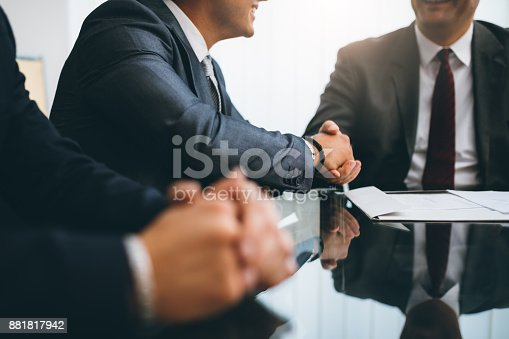 Business people shaking hands, finishing up a deal