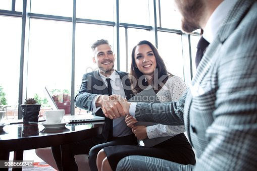 istock Business people shaking hands, finishing up a meeting. 938559242
